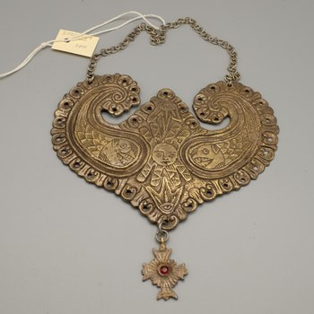 Breast ornament with suspended cross