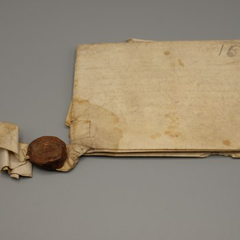 Official document written on parchment with attached wax sealing